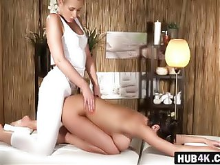 Two hot lesbians with oiled pussies on the massage table