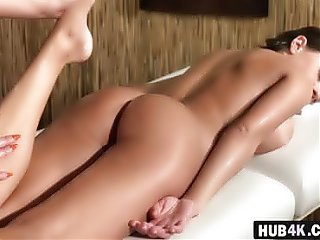Two busty lesbians having fun after hot oily massage