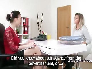Brunette female agent eats sexy blonde in office
