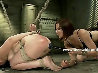 Lesbians enjoy spanking and domination in rough whipped ass video using ropes toys and strapon