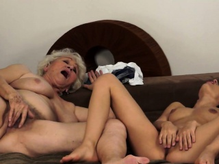 Lesbo granny orally satisfying a young babe